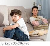 Купить «Offended tweenager after disagreements with mom», фото № 30696470, снято 28 марта 2019 г. (c) Яков Филимонов / Фотобанк Лори