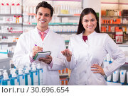 team of pharmaceutist and technician working in chemist shop. Стоковое фото, фотограф Яков Филимонов / Фотобанк Лори