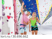 Купить «Couple of climbers dressed in rock climbing outfit training», фото № 30696662, снято 20 ноября 2019 г. (c) Яков Филимонов / Фотобанк Лори