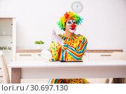 Купить «Male clown preparing for perfomance at home», фото № 30697130, снято 28 сентября 2018 г. (c) Elnur / Фотобанк Лори