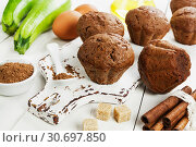Купить «Chocolate muffins with zucchini», фото № 30697850, снято 23 октября 2018 г. (c) Надежда Мишкова / Фотобанк Лори
