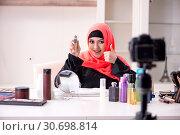 Купить «Beauty blogger in hijab recording video for her blog», фото № 30698814, снято 5 февраля 2019 г. (c) Elnur / Фотобанк Лори