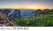 Купить «Panoramic view of the monasteries of Meteora at sunset», фото № 30699462, снято 4 июля 2018 г. (c) Sergii Zarev / Фотобанк Лори