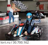 Купить «Pretty female go-cart racer crossing finish line», фото № 30700162, снято 25 августа 2019 г. (c) Яков Филимонов / Фотобанк Лори