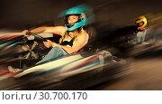 Купить «Female driving go-kart car indoor», фото № 30700170, снято 20 мая 2019 г. (c) Яков Филимонов / Фотобанк Лори