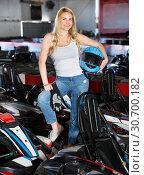 Купить «Female racer holding helmet on kart track», фото № 30700182, снято 25 августа 2019 г. (c) Яков Филимонов / Фотобанк Лори