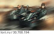 Купить «Jolly female go-cart racer crossing finish line», фото № 30700194, снято 18 марта 2019 г. (c) Яков Филимонов / Фотобанк Лори