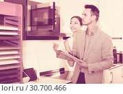 Купить «middle class satisfied family selecting kitchen furniture», фото № 30700466, снято 15 июня 2017 г. (c) Яков Филимонов / Фотобанк Лори