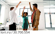 happy creative team making high five at office. Стоковое видео, видеограф Syda Productions / Фотобанк Лори