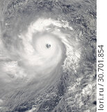 Купить «PACIFIC OCEAN Philippines -- 07 Nov 2013 -- This NASA MODIS Aqua satellite image shows what is possibly the strongest storm ever - Super Typhoon Haiyan...», фото № 30701854, снято 6 ноября 2018 г. (c) age Fotostock / Фотобанк Лори