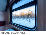 Купить «View of the window of a moving passenger train.», фото № 30704482, снято 6 марта 2019 г. (c) Андрей Радченко / Фотобанк Лори