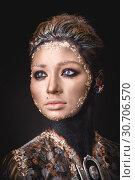 Купить «Portrait a girl with Golden icon painting makeup», фото № 30706570, снято 5 апреля 2019 г. (c) Sergii Zarev / Фотобанк Лори