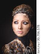 Купить «Portrait a girl with Golden icon painting makeup», фото № 30706578, снято 5 апреля 2019 г. (c) Sergii Zarev / Фотобанк Лори