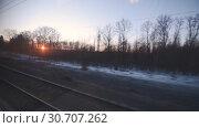 Купить «View from the window of a moving train», видеоролик № 30707262, снято 21 марта 2019 г. (c) Андрей Радченко / Фотобанк Лори