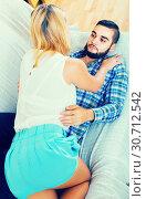 Excited boyfriend holding girl bending over him. Стоковое фото, фотограф Яков Филимонов / Фотобанк Лори