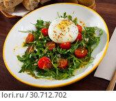 Купить «Salad with burrata cheese, pine nuts, cherry tomatoes and arugula», фото № 30712702, снято 23 июля 2019 г. (c) Яков Филимонов / Фотобанк Лори