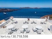 Купить «Greece, Santorini Island, terrace cafe on the background of the Aegean Sea», фото № 30718598, снято 10 июня 2017 г. (c) Наталья Волкова / Фотобанк Лори