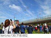 Купить «Военные самолёты пролетают над Москвой во время парада в честь Дня Победы 9 мая 2015 года в Москве», эксклюзивное фото № 30718602, снято 9 мая 2015 г. (c) lana1501 / Фотобанк Лори