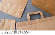 Купить «disposable paper bags», видеоролик № 30719554, снято 5 мая 2019 г. (c) Syda Productions / Фотобанк Лори