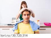 Купить «Woman hairdresser applying dye to man hair», фото № 30720314, снято 5 сентября 2018 г. (c) Elnur / Фотобанк Лори