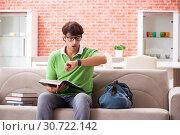 Купить «Young student preparing for exams at home», фото № 30722142, снято 11 сентября 2018 г. (c) Elnur / Фотобанк Лори