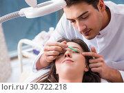 Купить «Young woman visiting male doctor cosmetologist», фото № 30722218, снято 16 ноября 2017 г. (c) Elnur / Фотобанк Лори