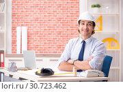 Купить «Construction supervisor working on blueprints», фото № 30723462, снято 13 сентября 2018 г. (c) Elnur / Фотобанк Лори