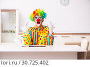 Купить «Male clown preparing for perfomance at home», фото № 30725402, снято 28 сентября 2018 г. (c) Elnur / Фотобанк Лори