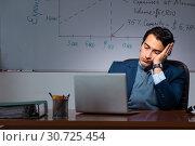Купить «Financial specialist working late in the office», фото № 30725454, снято 25 октября 2018 г. (c) Elnur / Фотобанк Лори