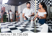 Купить «Five adults solving different conundrum in quest room», фото № 30726026, снято 6 июля 2017 г. (c) Яков Филимонов / Фотобанк Лори