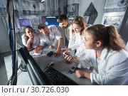 Купить «Five adults solving conundrums together in quest room in view as abandoned lab», фото № 30726030, снято 6 июля 2017 г. (c) Яков Филимонов / Фотобанк Лори