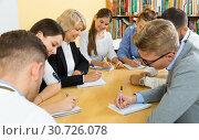 Купить «Students doing group study together in auditorium», фото № 30726078, снято 5 октября 2017 г. (c) Яков Филимонов / Фотобанк Лори