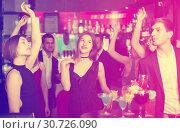 Купить «Glad colleagues dancing on corporate party», фото № 30726090, снято 20 апреля 2017 г. (c) Яков Филимонов / Фотобанк Лори