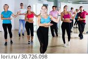 Купить «Positive energetic people dancing together», фото № 30726098, снято 9 октября 2017 г. (c) Яков Филимонов / Фотобанк Лори