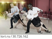Купить «Adult pairs dancing tango movements in modern dance studio», фото № 30726162, снято 4 октября 2018 г. (c) Яков Филимонов / Фотобанк Лори