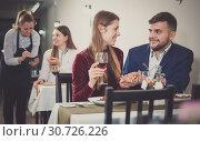 Купить «Gentleman with elegant woman are having dinner in luxury restaurante», фото № 30726226, снято 18 декабря 2017 г. (c) Яков Филимонов / Фотобанк Лори