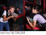 Купить «Group portrait of lucky people with laser guns», фото № 30726254, снято 23 августа 2018 г. (c) Яков Филимонов / Фотобанк Лори