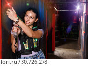 Купить «Portrait of young girl took aim colored laser guns during laser», фото № 30726278, снято 23 августа 2018 г. (c) Яков Филимонов / Фотобанк Лори
