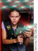 Купить «Happy girl took aim during laser tag game», фото № 30726282, снято 23 августа 2018 г. (c) Яков Филимонов / Фотобанк Лори