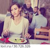 Купить «Portrait of upset woman in the restaurant with salad and wine», фото № 30726326, снято 11 декабря 2017 г. (c) Яков Филимонов / Фотобанк Лори