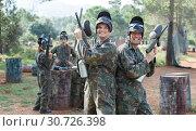 Купить «Two happy male friends in camouflage with guns ready for playing paintball», фото № 30726398, снято 22 сентября 2018 г. (c) Яков Филимонов / Фотобанк Лори