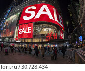 Купить «New York,NY/USA-December 18, 2018 The H&M department store in Times Square advertises their sale on merchandise, seen on Tuesday, December 18 2018. According...», фото № 30728434, снято 18 декабря 2018 г. (c) age Fotostock / Фотобанк Лори