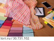 Купить «Advice about fabric choice and calculation of costs. Fabric store», фото № 30731102, снято 10 января 2018 г. (c) Сергей Молодиков / Фотобанк Лори
