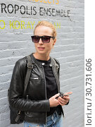 Купить «Woman using smartphone against colorful graffiti wall in New York city, USA.», фото № 30731606, снято 4 апреля 2020 г. (c) Matej Kastelic / Фотобанк Лори