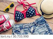 Купить «Beauty colorful bikini and accessories on wooden floor», фото № 30733990, снято 19 июля 2016 г. (c) easy Fotostock / Фотобанк Лори