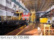 Купить «Russia, Khabarovsk, October 22, 2013: Locomotive depot of Khabarovsk, repair shop, locomotives repair», фото № 30735686, снято 22 октября 2013 г. (c) Катерина Белякина / Фотобанк Лори