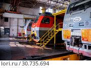 Купить «Russia, Khabarovsk, October 22, 2013: Locomotive depot of Khabarovsk, repair shop, locomotives repair», фото № 30735694, снято 22 октября 2013 г. (c) Катерина Белякина / Фотобанк Лори
