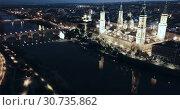Купить «Night aerial view of Zaragoza with Cathedral-Basilica of Our Lady of Pillar on bank of Ebro river, Spain», видеоролик № 30735862, снято 19 декабря 2018 г. (c) Яков Филимонов / Фотобанк Лори