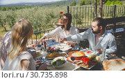 Купить «Portrait of four happy friends on a country ranch», видеоролик № 30735898, снято 26 апреля 2019 г. (c) Яков Филимонов / Фотобанк Лори