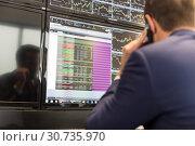 Купить «Stock broker trading online, talking on mobile phone.», фото № 30735970, снято 3 декабря 2014 г. (c) Matej Kastelic / Фотобанк Лори